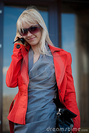Beautiful woman calling to cellphone