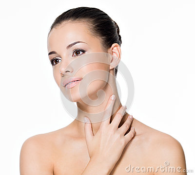 Beautiful woman cares of neck
