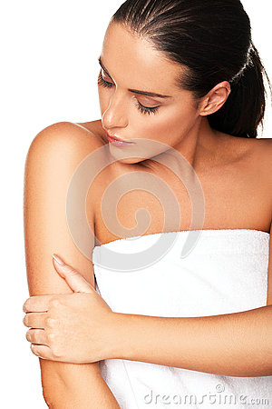 Beautiful woman caressing her arm