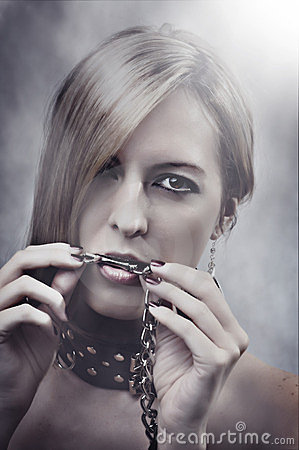 Beautiful Woman with chain in her mouth