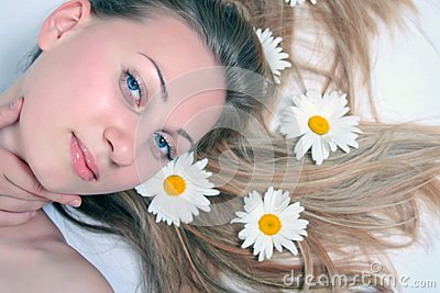 beautiful woman with chamomile