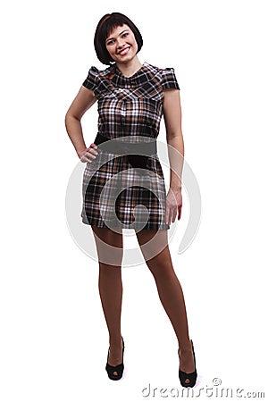 Beautiful woman in checkered dress