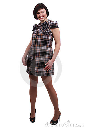 Beautiful woman in checkered dress.