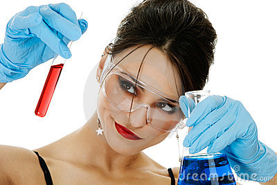 Beautiful woman with chemical glassware