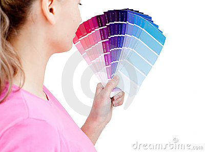 Beautiful woman choosing colors in her living-room