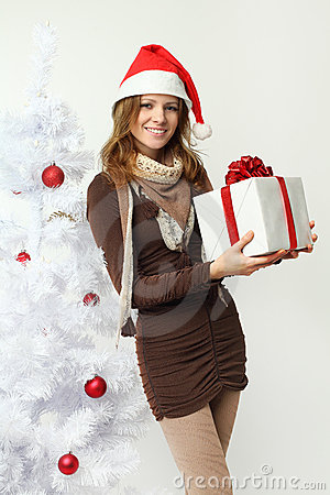 Beautiful woman with Christmas gift