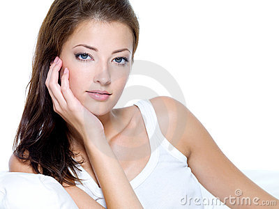Beautiful woman with clean skin sitting on sofa
