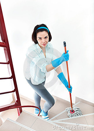 Beautiful woman cleaning stairs