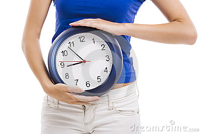 Beautiful woman with a clock