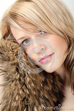 Beautiful woman in a coat fox fur collar