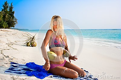 Beautiful woman with coconuts