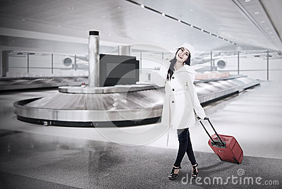 Beautiful woman collect luggage at airport