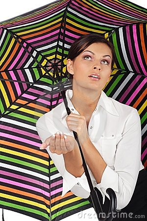 Beautiful woman with colourful umbrella on white b