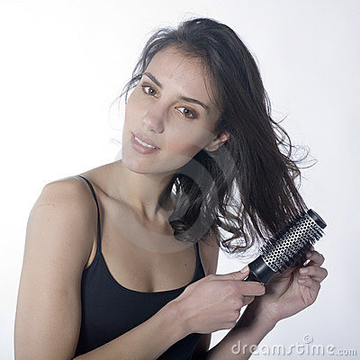 Beautiful woman combing her hair