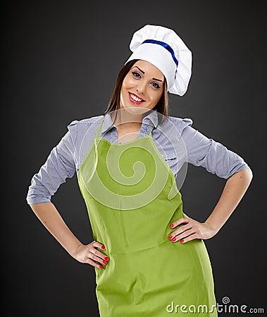 Beautiful woman cook standing akimbo