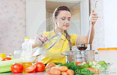 Beautiful woman cooking vegetarian food