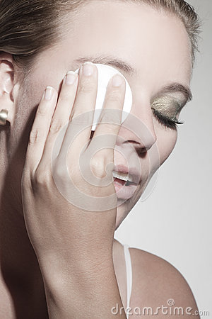 Beautiful woman with cosmetic pad