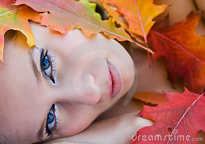 Beautiful woman covered in leaves