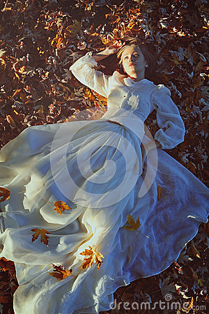 Free Beautiful Woman Daydreaming On A Bed Of Leaves Royalty Free Stock Photography - 62240547