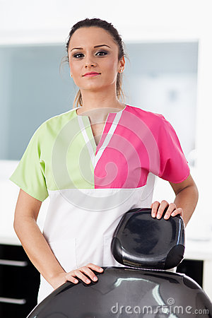 Beautiful woman dentist at the office