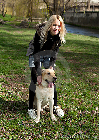 Beautiful woman with dog in the park