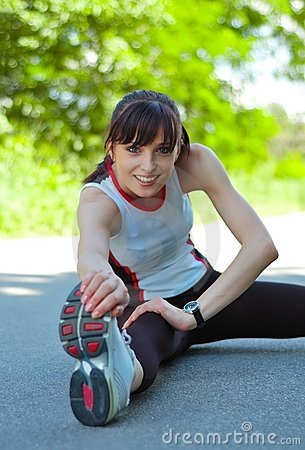 Beautiful Woman Doing Stretching Exercise in the P