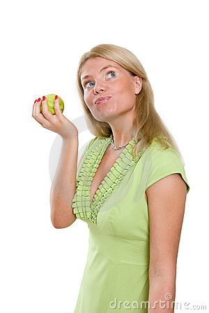 Beautiful woman dreaming and holding a green apple