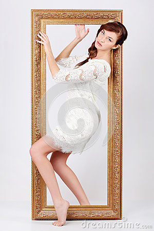 Beautiful woman in dress comes out of frame