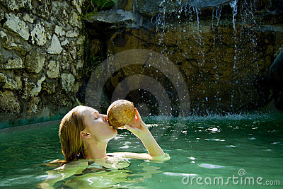 Beautiful woman drinking coconut