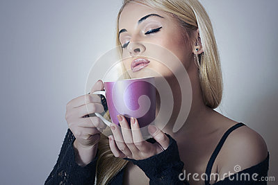 Beautiful woman drinking Coffee. Cup of tea.Delicious
