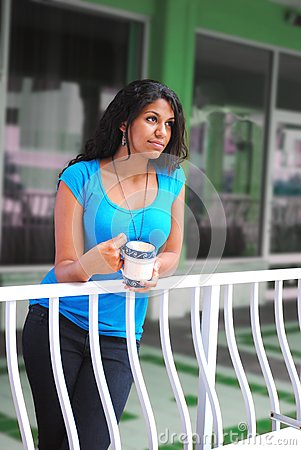 Beautiful woman drinking coffee in the morning