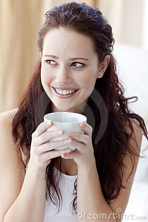 Beautiful Woman Drinking A Cup Of Coffee In Bed Stock Photos - Image: 11569003
