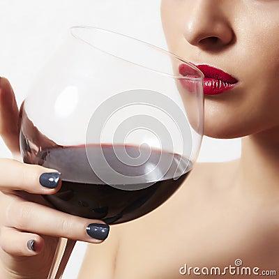 Beautiful woman drinking red wine.wineglass.red lips
