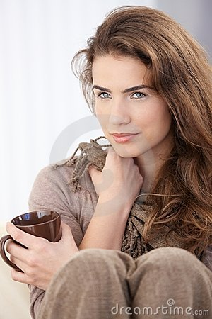 Beautiful woman drinking tea at home