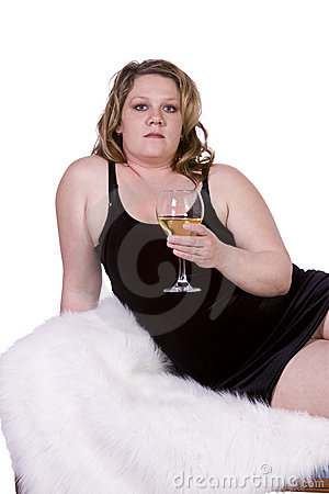 Beautiful Woman Drinking Wine on the Couch
