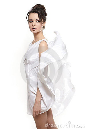 Beautiful woman earing white flying dress bride