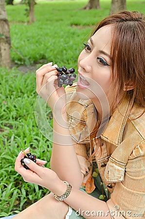 Beautiful woman eat fruit