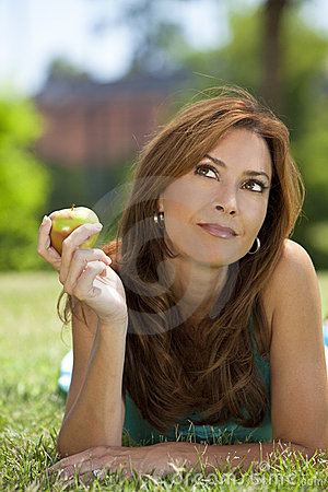 Beautiful Woman Eating An Apple & Thinking