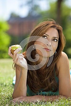 Beautiful Woman Eating An Apple & Thinking