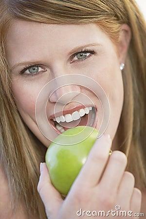 Free Beautiful Woman Eating Green Apple Stock Photo - 29650270