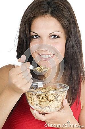 Beautiful woman eating her breakfast