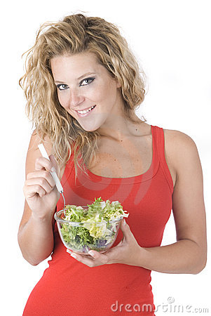 Beautiful woman eating a sane salad with vegetable