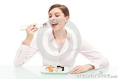 Beautiful woman eating sushi