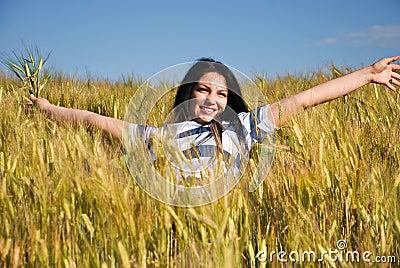 Beautiful woman enjoy summer in wheat field