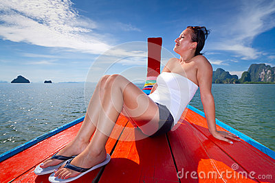 Beautiful woman enjoying boat trip in Thailand