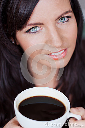 Beautiful woman enjoying cup of coffee