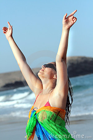 Beautiful woman enjoying freedom in the beach