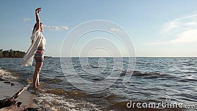 Beautiful woman enjoying leisure on the beach stock footage