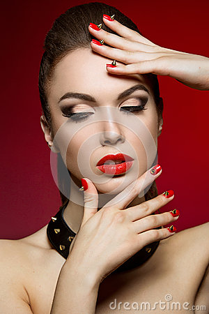 Beautiful woman with evening make-up and red nails