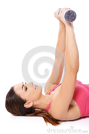 Beautiful woman exercising with barbells